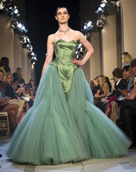 FILE - This Sept. 9, 2012 file photo shows a dress from the Zac Posen Spring 2013 collection during Fashion Week in New York. The rich, vibrant shade of emerald green is Pantone LLC&#039;s Color of the Year for 2013, beating out all the other shades of the rainbow. (AP Photo/John Minchillo, file)