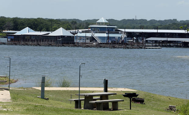 TEXHOMA LAKE DEVELOPMENT: Empty campgrounds and a deserted marina on the lake show the effects of destruction of the Lake Texhoma Lodge and cabins and a delay on construction of a new hotel on Wednesday, June 12, 2013 in Kingston, Okla.  Photo by Steve Sisney, The Oklahoman