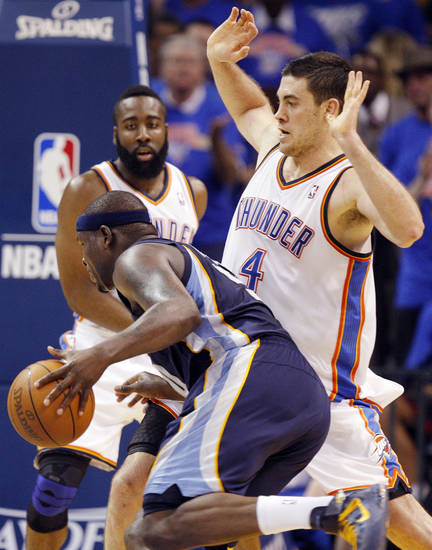Oklahoma City's Nick Collison (4) defends Zach Randolph (50) of Memphis as James Harden (13) of Oklahoma City looks on in the first half during game 7 of the NBA basketball Western Conference semifinals between the Memphis Grizzlies and the Oklahoma City Thunder at the OKC Arena in Oklahoma City, Sunday, May 15, 2011. Photo by Nate Billings, The Oklahoman