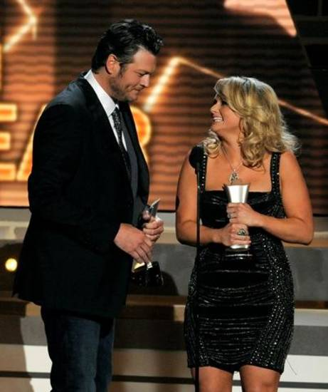 "Miranda Lambert, right, and Blake Shelton accept the award for song of the year for ""Over You"" at the 48th Annual Academy of Country Music Awards at the MGM Grand Garden Arena in Las Vegas on Sunday, April 7, 2013. (AP)"