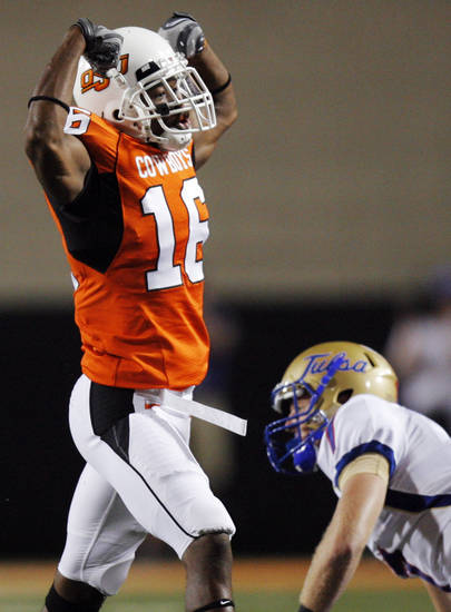 OSU's Andrae May (16) celebrates near Thomas Roberson (7) of TU after an interception during the college football game between the University of Tulsa (TU) and Oklahoma State University (OSU) at Boone Pickens Stadium in Stillwater, Oklahoma, Saturday, September 18, 2010. OSU won, 65-28. Photo by Nate Billings, The Oklahoman