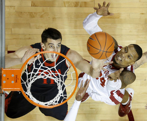 Oklahoma's Romero Osby (24) goes for the ball beside Texas Tech's Dejan Kravic (11) during an NCAA college basketball game between the University of Oklahoma and Texas Tech University at Lloyd Noble Center in Norman, Okla., Wednesday, Jan. 16, 2013. Photo by Bryan Terry, The Oklahoman