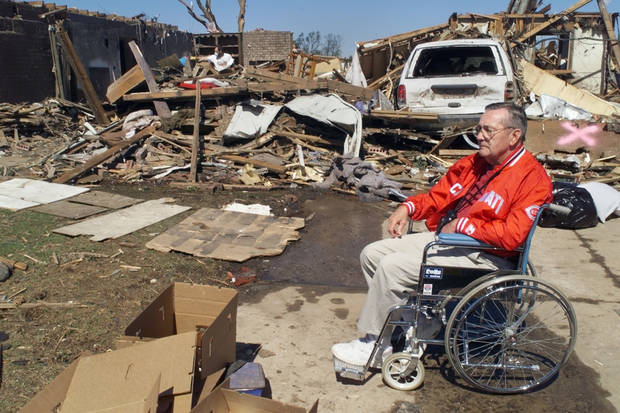 Tornado victims, damage: 79 yr.old Harlod Burrows watches clean up work at his home at 2209 Oakbrook in Del City.