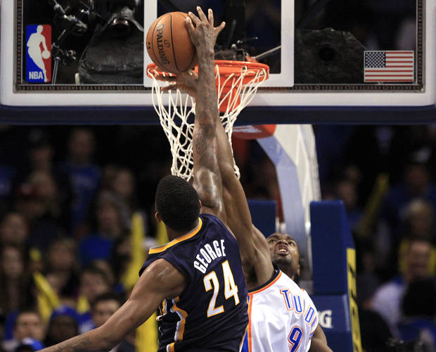 Oklahoma City's Serge Ibaka (9) blocks the shot of Indiana's Paul George (24) during the NBA game between the Indiana Pacers and the Oklahoma City Thunder at the Chesapeake Energy Arena   Sunday,Dec. 9, 2012. Photo by Sarah Phipps, The Oklahoman