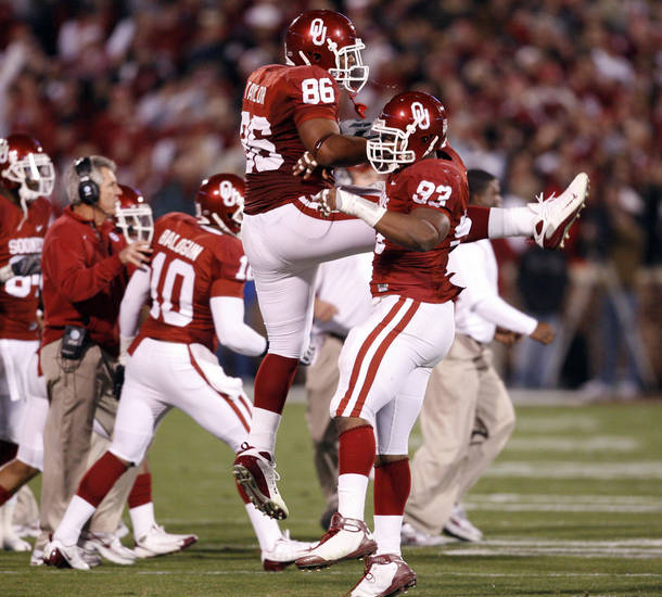 OU's Adrian Taylor (86)  and Gerald McCoy celebrate a stop during the first half of the college football game between the University of Oklahoma Sooners and Texas Tech University at the Gaylord Family -- Oklahoma Memorial Stadium on Saturday, Nov. 22, 2008, in Norman, Okla.   BY STEVE SISNEY, THE OKLAHOMAN