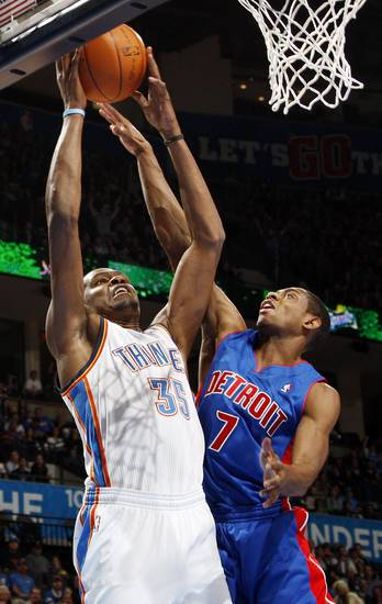 Oklahoma City's Kevin Durant (35) shoots as Brandon Knight (7) defends for Detroit during the NBA basketball game between the Detroit Pistons and Oklahoma City Thunder at the Chesapeake Energy Arena in Oklahoma City, Monday, Jan. 23, 2012. Photo by Nate Billings, The Oklahoman