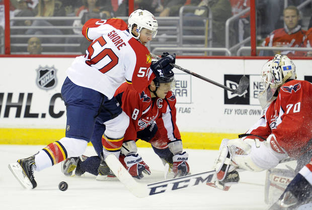 Florida Panthers center Drew Shore (50) looks for the puck against Washington Capitals left wing Alex Ovechkin (8), of Russia, and goalie Braden Holtby (70) during the second period of an NHL hockey game, Saturday, Feb. 9, 2013, in Washington. (AP Photo/Nick Wass)