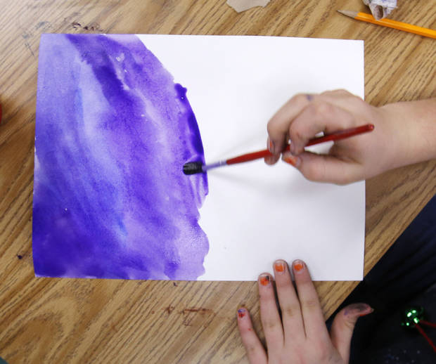 Shelby Johnson, a fourth-grader at Orvis Risner Elementary School, paints during art class. Photo  By Steve Gooch, The Oklahoman <strong>Steve Gooch - The Oklahoman</strong>