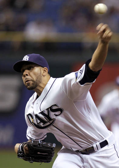 FILE - This June 13, 2012 file photo shows Tampa Bay Rays starting pitcher David Price delivers in the first inning to the New York Mets during an interleague baseball game in St. Petersburg, Fla. Price and 2011 winner Justin Verlander are among the finalists for this year's AL Cy Young Award, Wednesday, Nov. 14, 2012. (AP Photo/Chris O'Meara, File)