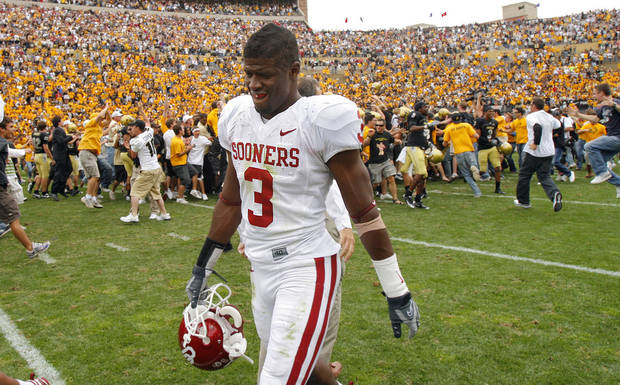 Oklahoma's Reggie Smith (3) walks off the field as Colorado and its fans celebrate the 27-24 upset of over the Sooners during the college football game between the University of Oklahoma Sooners (OU) and the University of Colorado Buffaloes (CU) at Folsom Field on Saturday, Sept. 28, 2007, in Boulder, Co. 