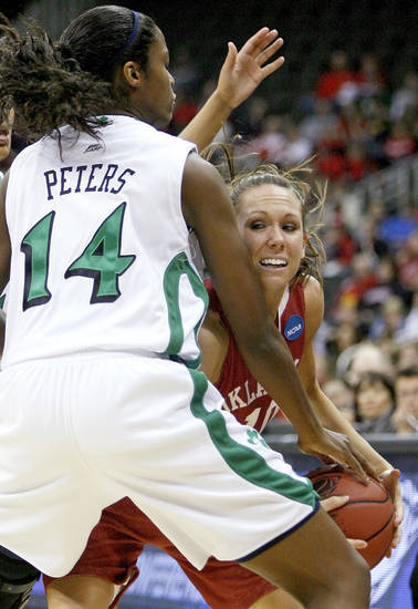 OU's Carlee Roethlisberger tries to get around Notre Dame's Devereaux Peters during the Sweet 16 round of the NCAA women's  basketball tournament in Kansas City, Mo., on Sunday, March 28, 2010. 