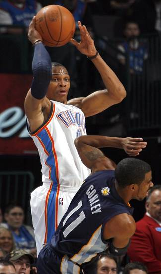 Oklahoma City's Russell Westbrook (0) looks to pass as Memphis' Mike Conley (11) during the NBA basketball game between the Oklahoma City Thunder and the Memphis Grizzlies, Saturday, Jan. 8, 2011, at the Oklahoma City Arena. Photo by Sarah Phipps, The Oklahoman