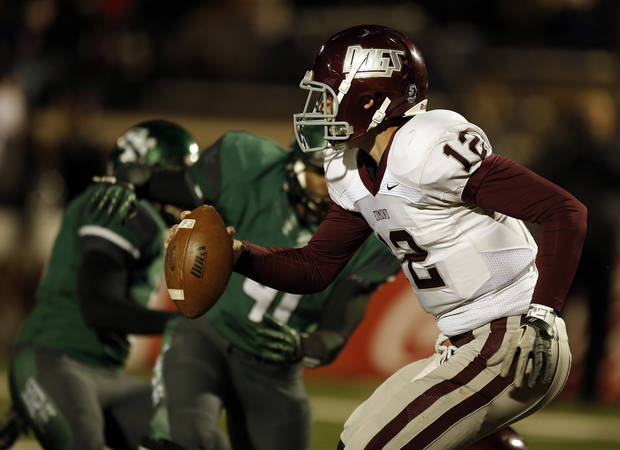Memorial's Tyler Holcomb (12) runs the ball during a high school football game between Edmond Memorial and Edmond Santa Fe at Wantland Stadium in Edmond, Okla., Friday, Oct. 26, 2012.  Photo by Garett Fisbeck, The Oklahoman