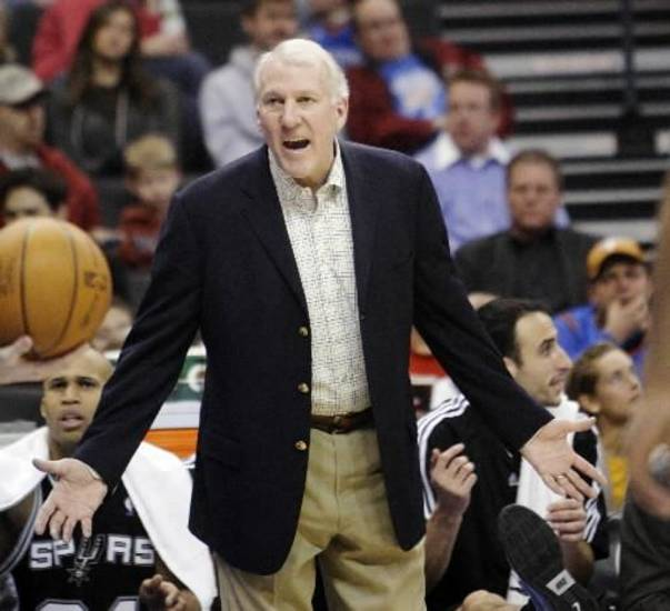 San Antonio Spurs coach  Gregg  Popovich questions the call of an official in the fourth quarter of an NBA basketball game against the Oklahoma City Thunder in Oklahoma City, Wednesday, Jan. 13, 2010. San Antonio won 109-108 in overtime. (AP Photo/Sue Ogrocki)