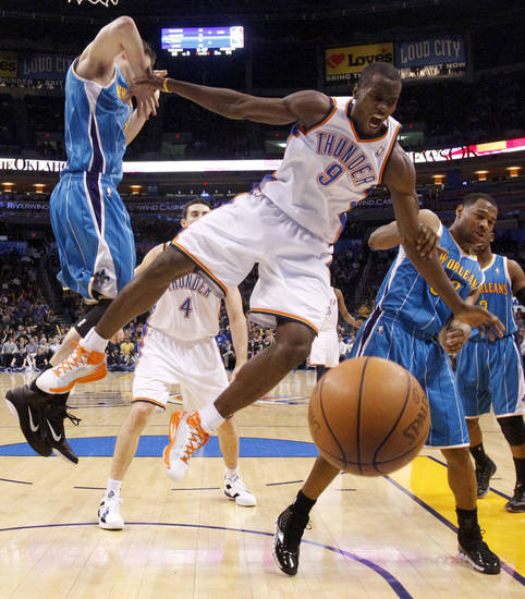 Oklahoma City's Serge Ibaka (9) gets caught between New Orleans' Jason Smith (14) and New Orleans' Willie Green (33) during the NBA basketball game between the Oklahoma City Thunder and the New Orleans Hornets, Wednesday, Feb. 2, 2011 at the Oklahoma City Arena. Photo by Bryan Terry, The Oklahoman