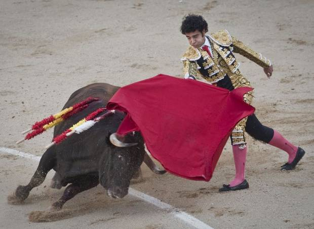 Spanish bullfighter Francisco Pajares performs during a bullfight at the Las Ventas Bullring in Madrid, Sunday, April 10, 2011. Bullfighting is an ancient tradition in Spain and the season runs from March to October. (AP Photo/Arturo Rodriguez) ORG XMIT: AR116