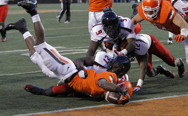 Oklahoma State's Joseph Randle (1) is brought down short of the touchdown by the Texas Tech defense during the college football game between the Oklahoma State University Cowboys (OSU) and Texas Tech University Red Raiders (TTU) at Boone Pickens Stadium on Saturday, Nov. 17, 2012, in Stillwater, Okla.   Photo by Chris Landsberger, The Oklahoman