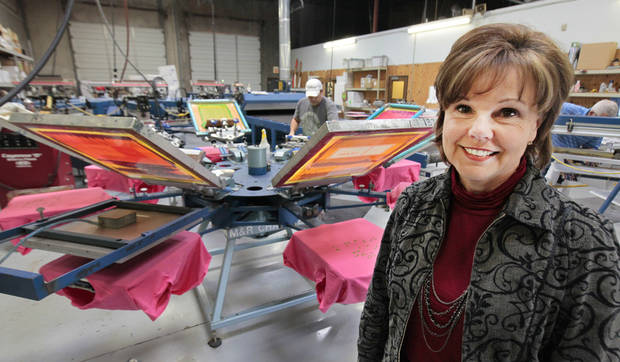 Pam Guffey, owner of Gold Star Graphics embroidery and screen printing, Tuesday, March 19, 2013. Photo By David McDaniel/The Oklahoman