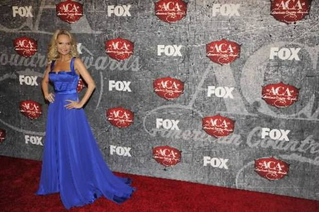 Kristin arrives at the ACA Awards. (AP photos)