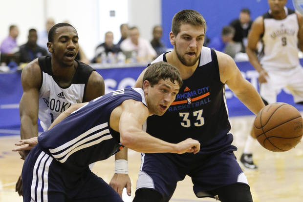Oklahoma City's Michael Stockton, front left, and Mitch McGary go after a loose ball during Monday's summer league game in Orlando, Fla.                                                                                     AP Photo