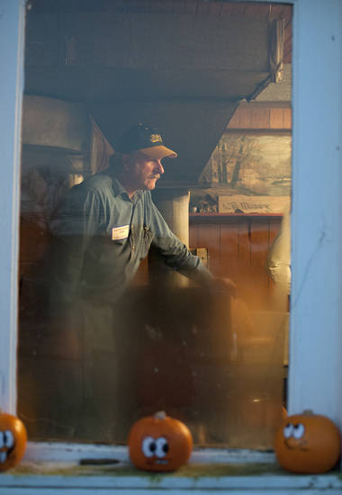 Election official John James watches over the voting on Election Day, Tuesday, Nov. 6, 2012, at the Elizaville precinct in Elizaville, Ky. The precinct is located in Flora's Grocery Store, built in 1821. (AP Photo/John Flavell)