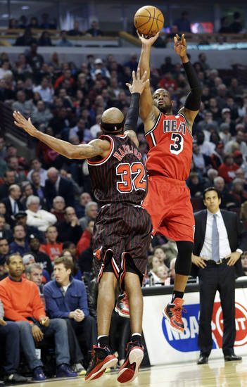 Miami Heat guard Dwyane Wade (3) shoots over Chicago Bulls guard Richard Hamilton during the first half of an NBA basketball game in Chicago, Thursday, Feb. 21, 2013. (AP Photo/Nam Y. Huh)