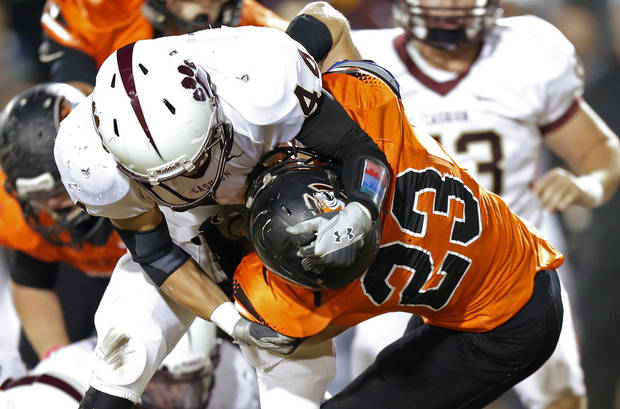 Cashion's T.J. Martin brings down Crescent's Michael Cronister during a high school football game between Cashion and Crescent in Crescent, Okla., Thursday, Oct. 18, 2012.  Photo by Bryan Terry, The Oklahoman