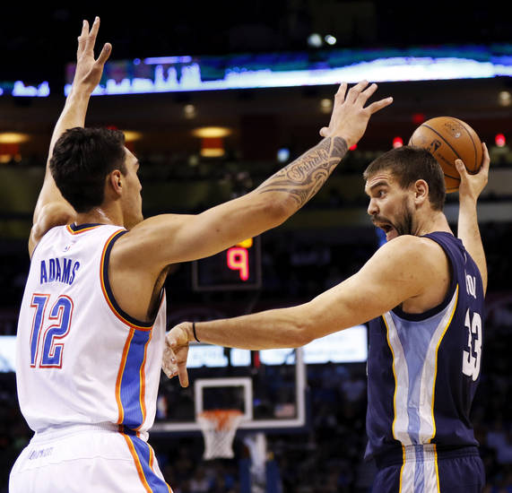FILE - Memphis' Marc Gasol (33) passes away from Oklahoma City's Steven Adams (12) during an NBA basketball game between the Oklahoma City Thunder and the Memphis Grizzlies at Chesapeake Energy Arena in Oklahoma City, Friday, Nov. 7, 2014. Photo by Nate Billings, The Oklahoman