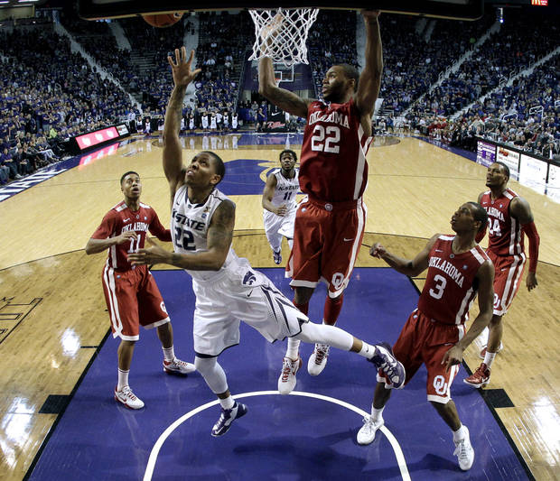 Kansas State guard Rodney McGruder (22) gets past Oklahoma forward Amath M'Baye (22) to put up a shot during the second half of an NCAA college basketball game Saturday, Jan. 19, 2013, in Manhattan, Kan. Kansas State won the game 69-60. (AP Photo/Charlie Riedel)