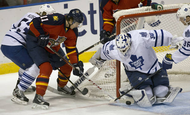 Toronto Maple Leafs goalie Ben Scrivens blocks a shot on goal by Florida Panthers' Jonathan Huberdeau (11) during the first period of an NHL hockey game in Sunrise, Fla., Monday, Feb. 18, 2013.  (AP Photo/J Pat Carter)