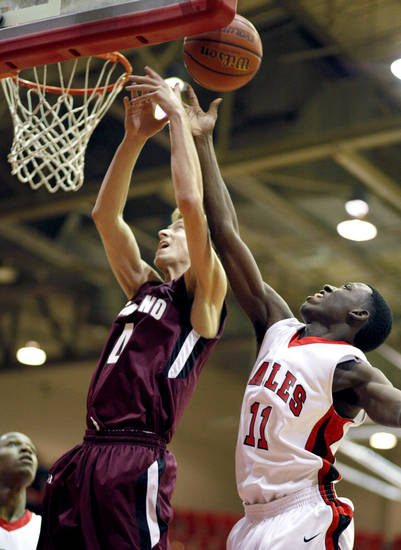 Del City's Jamal Moseley blocks the shot of Edmond Memorial's Jordan Thomas Tuesday night.