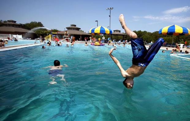 CHILD / CHILDREN / KIDS / WATER / SUMMER / HEAT / HOT WEATHER: Noah Shemely, 11, dives into the pool at Pelican Bay Aquatic Center in Edmond, Okla., Sunday, Aug. 28, 2011. Photo by Sarah Phipps, The Oklahoman ORG XMIT: KOD