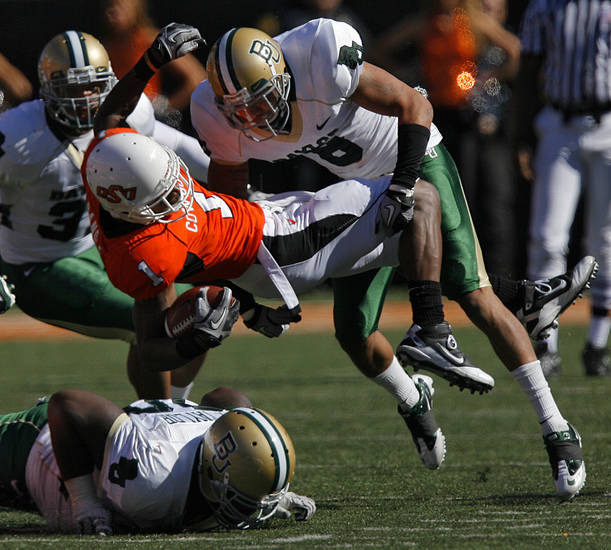 Baylor's Tevin Elliott (18) takes down Oklahoma State's Joseph Randle (1) during the college football game between the Oklahoma State University Cowboys (OSU) and the Baylor University Bears at Boone Pickens Stadium in Stillwater, Okla., Saturday, Nov. 6, 2010. Photo by Chris Landsberger, The Oklahoman