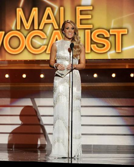 Checotah native Carrie Underwood presents the award for male vocalist of the year at the 49th annual Academy of Country Music Awards at the MGM Grand Garden Arena on Sunday, April 6, 2014, in Las Vegas. (AP)