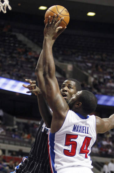 Orlando Magic power forward Andrew Nicholson takes a shot over Detroit Pistons forward Jason Maxiell (54) in the first half of an NBA basketball game Friday, Nov. 16, 2012, in Auburn Hills, Mich. (AP Photo/Duane Burleson)