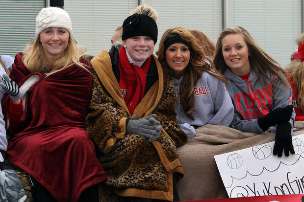 Yukon High School girls basketball players are all smiles during the 47th annual Czech Festival parade Saturday in Yukon. PHOTO BY HUGH SCOTT FOR THE OKLAHOMAN