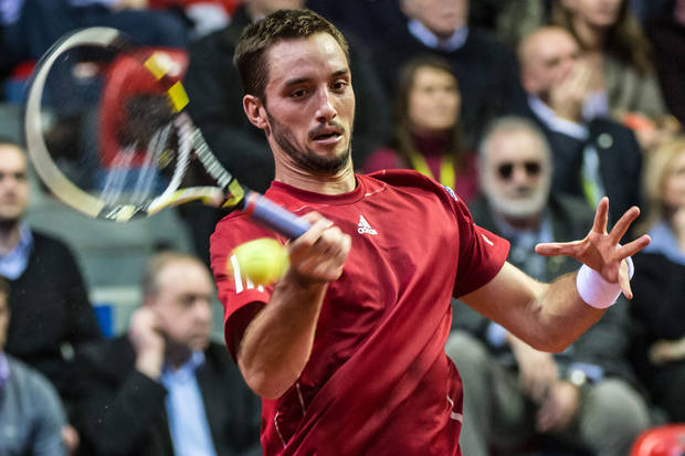 Serbia's Viktor Troicki returns the ball during the Davis Cup World Group first round match against Belgium's David Goffin at the Spriroudome in Charleroi, Belgium, Friday Feb. 1, 2013. (AP Photo/Geert Vanden Wijngaert)