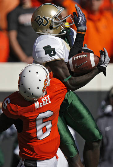 Oklahoma State's Andrew McGee (6) breaks up a pass for Baylor's Kendall Wright (1) during the college football game between the Oklahoma State University Cowboys (OSU) and the Baylor University Bears at Boone Pickens Stadium in Stillwater, Okla., Saturday, Nov. 6, 2010. Photo by Chris Landsberger, The Oklahoman