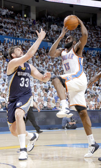 Oklahoma City's James Harden (13) drives for a lay up as Marc Gasol (33) of Memphis defends during game five of the Western Conference semifinals between the Memphis Grizzlies and the Oklahoma City Thunder in the NBA basketball playoffs at Oklahoma City Arena in Oklahoma City, Wednesday, May 11, 2011. Photo by Bryan Terry, The Oklahoman