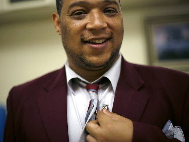 Glenn, who attends the Oklahoma Foundation for the disabled, poses with a ring that he gave to a girlfriend at the annual prom.