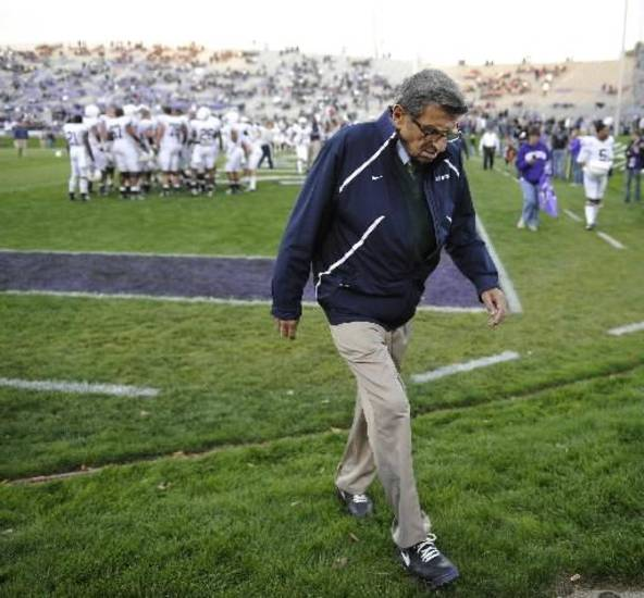 "Oct. 22, 2011 file photo, Penn State coach Joe Paterno walks off the field after warmups before Penn State's NCAA college football game against Northwestern in Evanston, Ill. Paterno and other senior Penn State officials ""concealed critical facts"" about Jerry Sandusky's child abuse because they were worried about bad publicity, according to an internal investigation into the scandal released Thursday July 12, 2012. (AP Photo/Jim Prisching)"