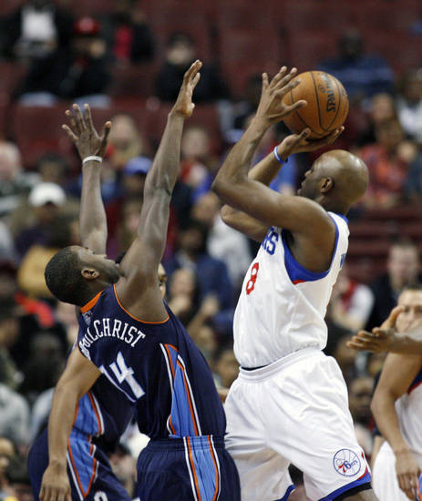 Charlotte Bobcats' Michael Kidd-Gilchris (14) defends as Philadelphia 76ers' Damien Wilkins (8) shoots in the first half of an NBA basketball game, Saturday, March 30, 2013, in Philadelphia. (AP Photo/H. Rumph Jr)