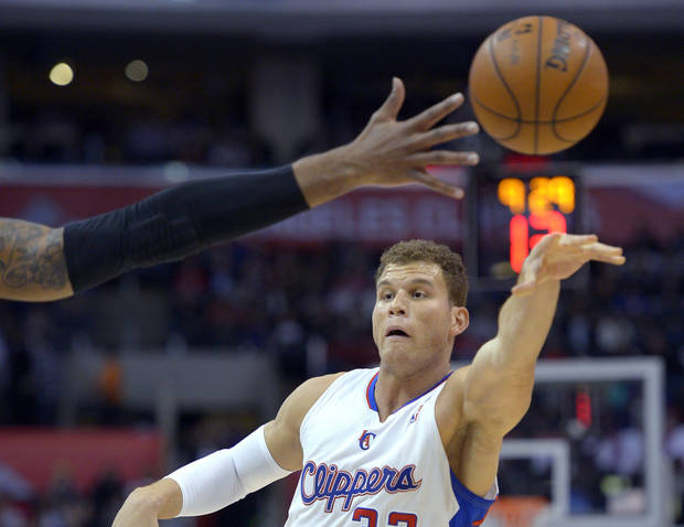 Los Angeles Clippers forward Blake Griffin passes the ball as Portland Trail Blazers forward LaMarcus Aldridge reaches for it during the first half of an NBA basketball game, Sunday, Jan. 27, 2013, in Los Angeles. (AP Photo/Mark J. Terrill)