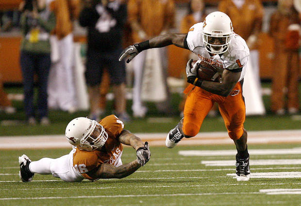 Oklahoma State's Joseph Randle (1) slips past Texas' Kenny Vaccaro (16) during the college football game between the Oklahoma State University Cowboys (OSU) and the University of Texas Longhorns (UT) at Darrell K Royal-Texas Memorial Stadium in Austin, Texas, Saturday, November 13, 2010. Photo by Sarah Phipps, The Oklahoman ORG XMIT: KOD