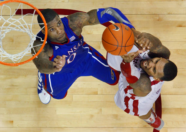 Oklahoma Sooner Romero Osby (24) shoots over Kansas Jayhawk Thomas Robinson (0) as the University of Oklahoma (OU) Sooners play the Kansas Jayhawks  in men's college basketball at the Lloyd Noble Center on Saturday, Jan. 7, 2012, in Norman, Okla.   Photo by Steve Sisney, The Oklahoman