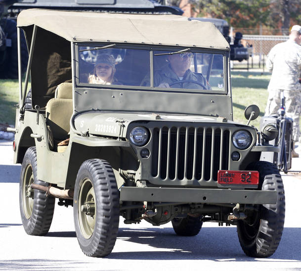 Air Force veteran Tim Kline drives his 1943 Ford Jeep with his 8yr old granddaughter Haileigh Combs during the 45th Infantry Museum's Veteran's Day ceremony in Oklahoma City , Friday November, 11,  2011. Photo by Steve Gooch