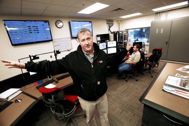 University of Oklahoma facilities manager Brian Ellis shows the modern control room in the new power, heat and air conditioning facility as he shows energy saving enhancements to the Norman campus.  Photo by Steve Sisney, The Oklahoman