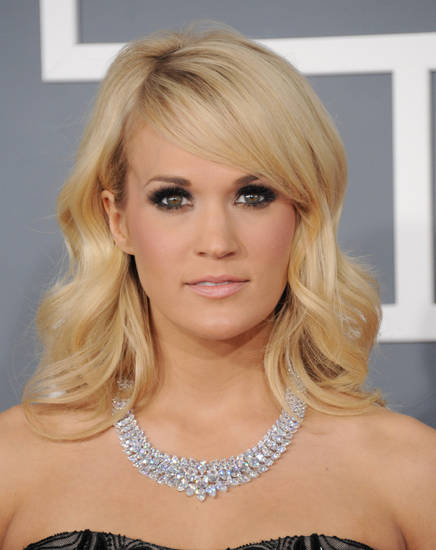 Carrie Underwood arrives at the 55th annual Grammy Awards on Sunday, Feb. 10, 2013, in Los Angeles.  (Photo by Jordan Strauss/Invision/AP) ORG XMIT: CADC240
