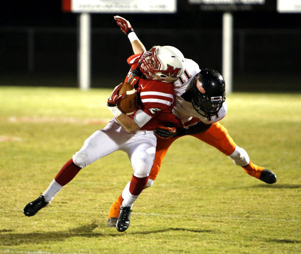 Douglass&#039; Anthony Williams tackles McLoud&#039;s Will Olds in high school football on Thursday, Oct. 18, 2012 in McLoud , Okla.  Photo by Steve Sisney, The Oklahoman