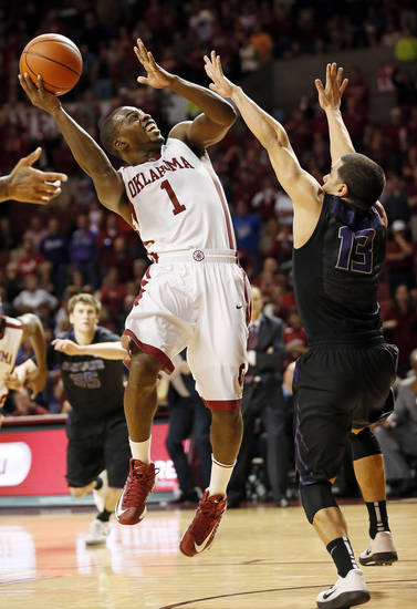 Oklahoma's Sam Grooms (1) takes a shot against Kansas State's Angel Rodriguez (13) to tie the game in the final minute during an NCAA men's basketball game between the University of Oklahoma (OU) and Kansas State at the Lloyd Noble Center in Norman, Okla., Saturday, Feb. 2, 2013. Kansas State won, 52-50. Photo by Nate Billings, The Oklahoman